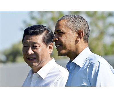 واشنطن وبكين تعلنان التوتر بينهما 152912112014083438.jpg