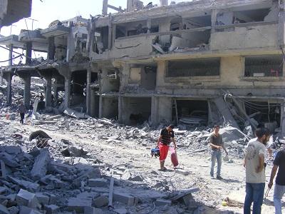 الجيش الصهيوني يقصف أبراج سكنية 2014161.jpg